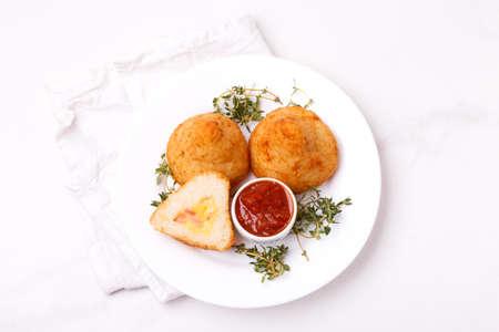 sicilian arancini di riso. fried risotto rice balls. italian  food. Coxinha of chicken, Brazilian snack with herbs and marinara tomato sauce