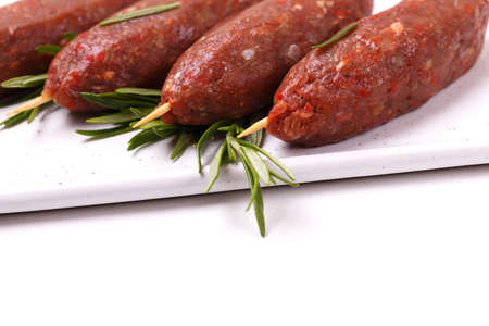 raw lula kebab, lyulya-kebab minced meat, shish kebab ready to cook with rosemary. Caucasian cuisine. Fast food. Eastern food.