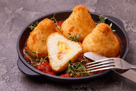 sicilian arancini di riso. fried risotto rice balls. italian  food. Coxinha of chicken, Brazilian snack with herbs and marinara tomato sauce