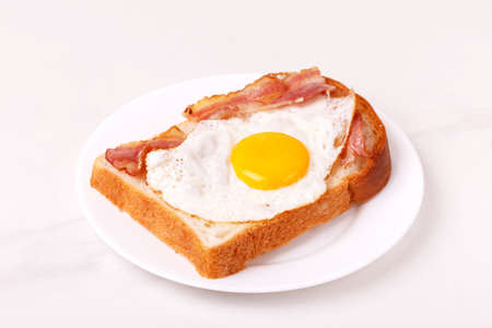Sandwich with fried egg and bacon. Traditional breakfast