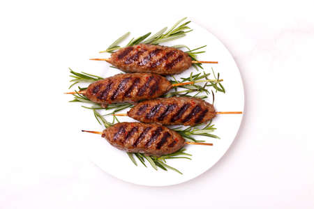 Lula kebab, lyulya-kebab minced meat, shish kebab grilled with rosemary. Caucasian cuisine. Fast food. Eastern food. 스톡 콘텐츠