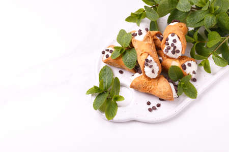 Traditional sicilian dessert cannoli with chocolate and ricotta. Italian cuisine