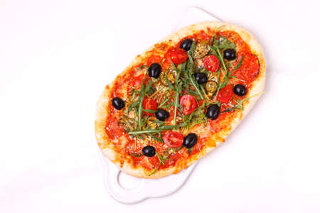 classic Italian pepperoni pizza pinza with olives and arugula. top view 스톡 콘텐츠