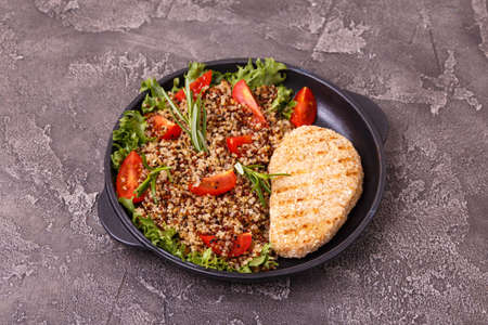 Grilled Chicken or Turkey Breast with rosemary with quinoa tomato salad, top view 스톡 콘텐츠
