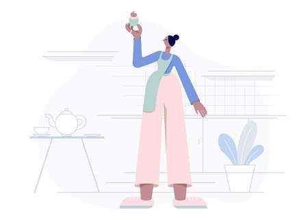 Woman in the apron stands in the kitchen and holds a muffin. Homemade cake. Flat geometric style vector illustration.