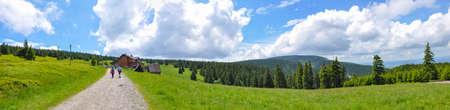 Tourists with backpacks on the trail, mountain hostel, Snieznik Mountains, Kralicky Sneznik, Miedzygorze, Lower Silesia, Polish mountains, Poland Reklamní fotografie