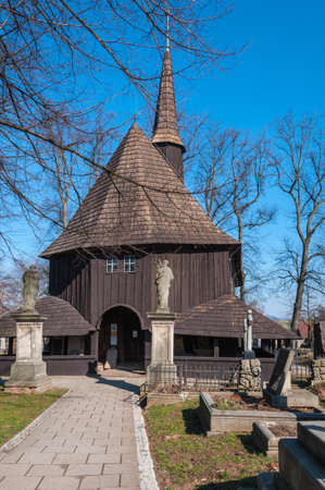 The oldest wooden church - Broumov, Czech Republic, Wooden church of the Virgin Mary and the cemetery Stock Photo