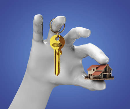 Hand holding small house and some keys