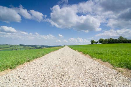 地上道路上の青い空 写真素材