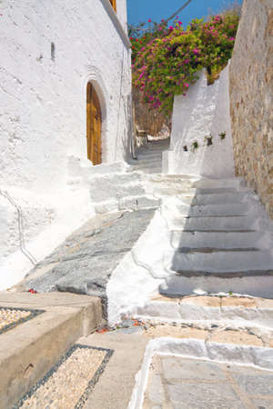 Small greek street in Lindos, Rhodes, Greece  photo