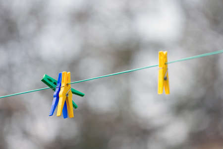 colorful clothespins ready to go to work on a sunny summer day Stock Photo - 14876400