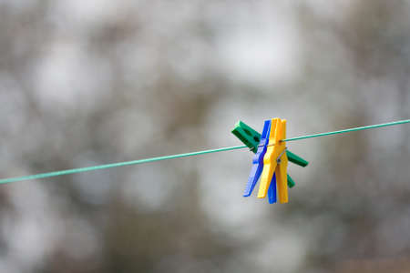 colorful clothespins ready to go to work on a sunny summer day  Stock Photo - 14876401