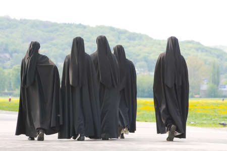 Five nuns walking