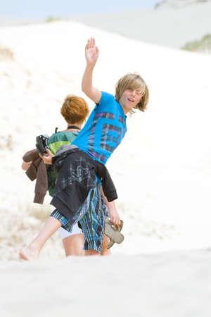 having fun in winter time: Cheerful boy waving his hands  Stock Photo