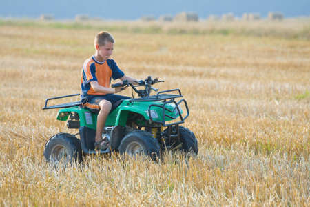 Boy riding a quad bike photo