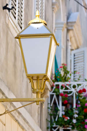 Street lamp on a textured brick wall Stock Photo - 16033435