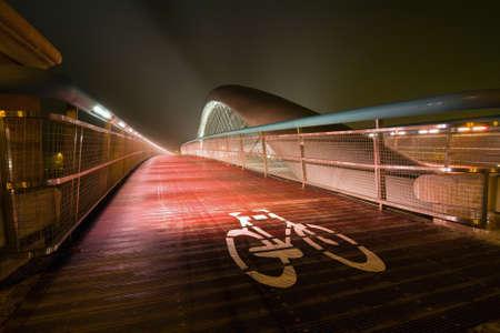 Modern footbridge Bernatka during sundown in Krakow, Poland, Europe Stock Photo - 16849325