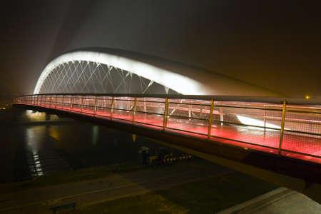 Modern footbridge Bernatka during sundown in Krakow, Poland, Europe Stock Photo - 16849220