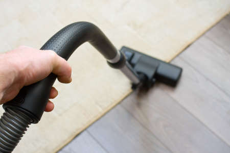Vacuum cleaner to tidy up the living room  Stock Photo - 16848673