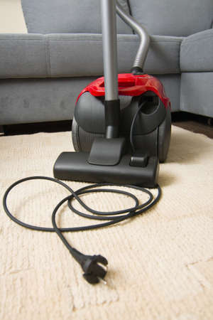 Vacuum cleaner to tidy up the living room  Stock Photo - 16848988
