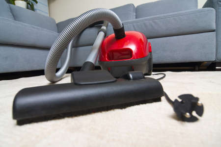 Vacuum cleaner to tidy up the living room  Stock Photo - 16848853