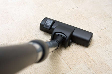 Vacuum cleaner to tidy up the living room Stock Photo - 16881098