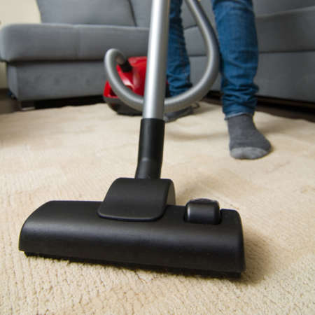 Vacuum cleaner to tidy up the living room  Stock Photo - 16880946