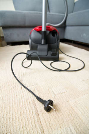 Vacuum cleaner to tidy up the living room Stock Photo - 16881020