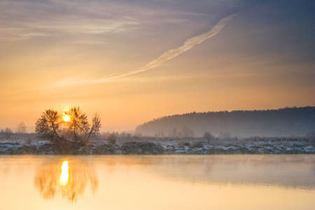 Winter sunrise over the river  photo