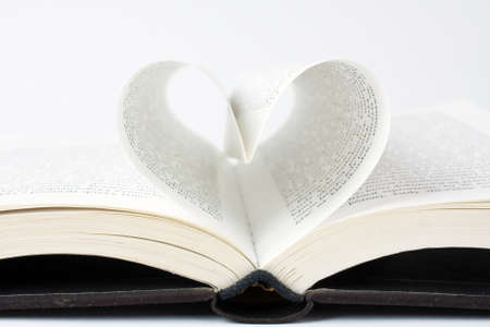 Book with pages folded into a heart shape  photo