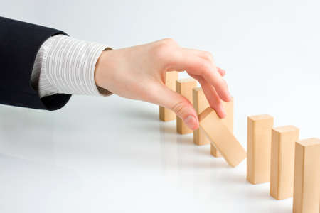 Concept for solution to a problem by stopping the domino effect photo
