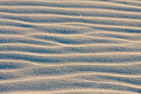 Dune sur la plage au coucher du soleil