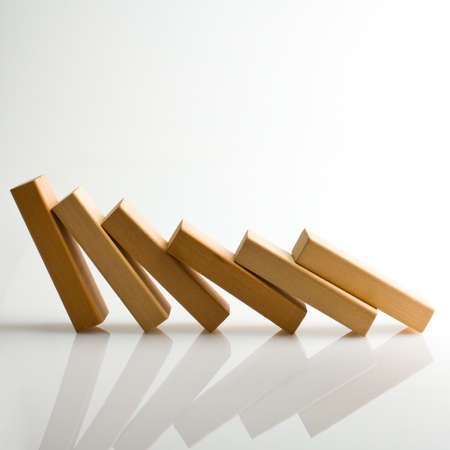 Domino effect - row of white dominoes on white background Stock Photo - 18566694