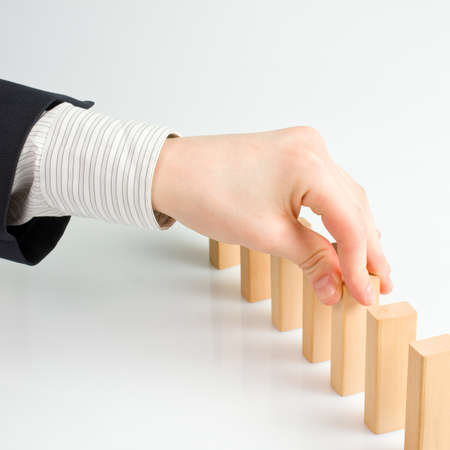 Concept for solution to a problem by stopping the domino effect Stock Photo - 18566712