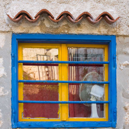 Yellow and blue window, Dalmatia, Croatia photo