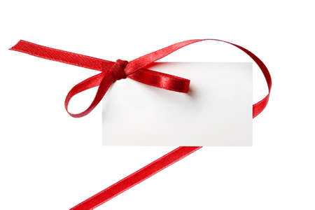 Blank gift tag tied with a bow of red satin ribbon  Isolated on white, with soft shadow  photo