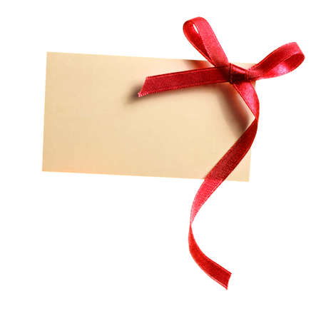 gift tag: Blank gift tag tied with a bow of red satin ribbon  Isolated on white, with soft shadow