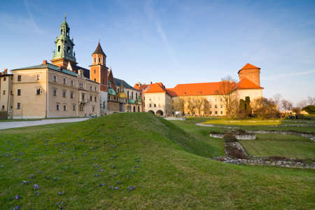viewed from behind: View of the beautiful Saint Stanislas Cathedral at Wawel castle, Krakow, Poland, viewed from behind a gothic arch