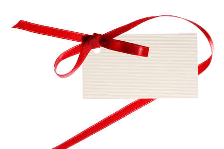 Blank gift tag tied with a bow of satin ribbon. Isolated on white, with soft shadow  photo