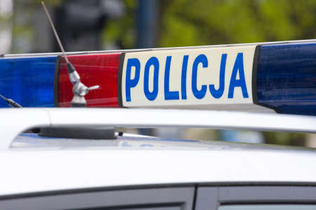Polish police sign on a roof of police car  Stock Photo