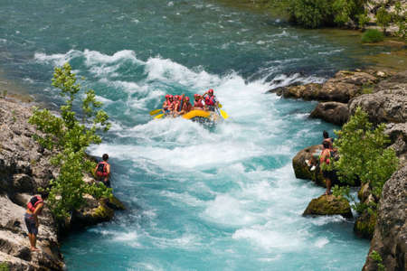 rafters:  GREEN CANYON, TURKEY - JULY 10, 2010  White water rafting on the rapids of river Manavgat on July 10, 2009 in Green Canyon, Turkey  Manavgat River is one of the most popular among rafters in Turkey