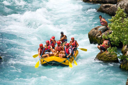 rafting:  GREEN CANYON, TURKEY - JULY 10, 2010  White water rafting on the rapids of river Manavgat on July 10, 2009 in Green Canyon, Turkey  Manavgat River is one of the most popular among rafters in Turkey