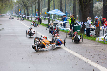 KRAKOW, POLAND - APRIL 28   Cracovia Marathon Handicapped man marathon runners in a wheelchair on the city streets on April 28, 2013 in Krakow, POLAND