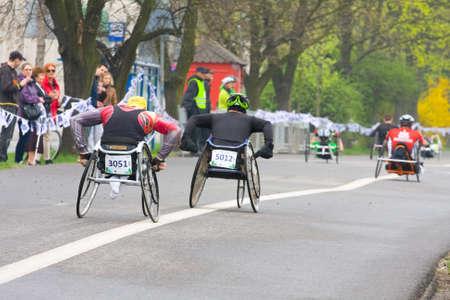 cracovia:  KRAKOW, POLAND - APRIL 28   Cracovia Marathon Handicapped man marathon runners in a wheelchair on the city streets on April 28, 2013 in Krakow, POLAND  Editorial