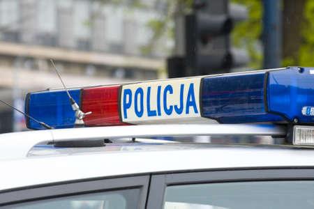 Polish police sign on a door of police car