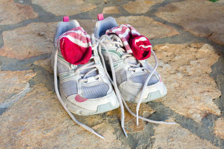 pair of old used running shoes with socks photo