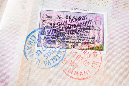 foreign national: Passport stamps background with various countries