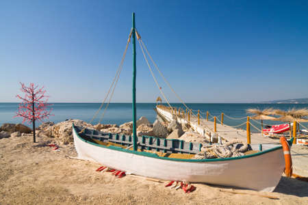 balchik: Boat on the beach at sunrise time  Stock Photo