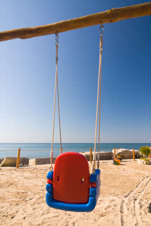 swings on the beach  photo
