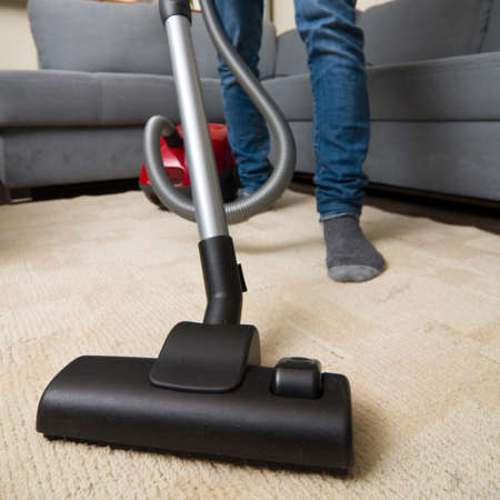 vacuum: cleaning home with vacuum cleaner  Stock Photo